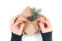 Woman`s hands wrapping Christmas gift box Stock Image