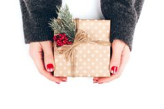 Woman`s hands wrapping Christmas gift box Royalty Free Stock Photo