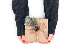 Woman`s hands wrapping Christmas gift box Royalty Free Stock Photos