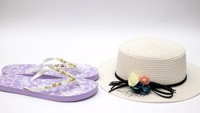Woman`s hat slippers sunglasses and sea shell on the white background - Stop motion stock video