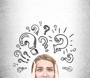 Woman`s head and black question marks Royalty Free Stock Image