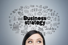 Woman s head and business strategy Stock Images