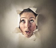 Woman's head in a hole Stock Photography