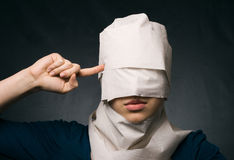 Woman's head wrapped in paper. Royalty Free Stock Image