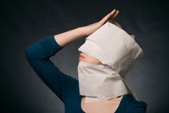 Woman's head wrapped in paper. Stock Images