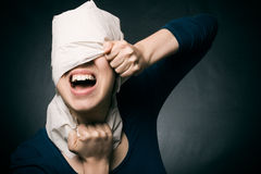 Woman's head wrapped in paper. Royalty Free Stock Photography