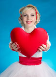 Woman's heart Valentine's Day. Woman holding a big heart on Valentine's Day Stock Images