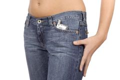 Woman's hip wearing jeans with mobile phone in the pocket Stock Images
