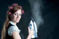 Woman's holding hot iron Stock Image