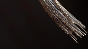 Woman`s jewelry earrings. Waving slowmotion stock video