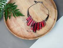 Woman`s Jewelry. Ruby necklace on wooden desk royalty free stock images