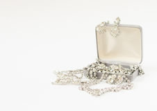 Woman& x27;s Jewelry. Vintage jewelry background. Beautiful rhinestone brooches and necklace in a jewelry box on white background. Royalty Free Stock Photo