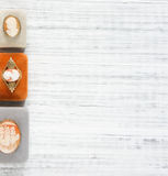 Woman`s Jewelry. Vintage jewelry background. Beautiful vintage cameo brooches and jewelry boxes on white background. Flat lay, to Royalty Free Stock Photography