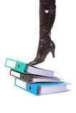 Woman's leg in boot standing on folder, isolated Royalty Free Stock Photography
