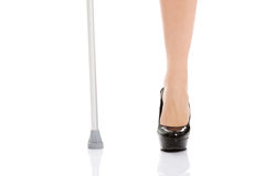 Woman's leg and a crutch. Disabled concept. Royalty Free Stock Images