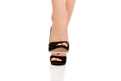 Woman's leg in high heels trying to trample something Royalty Free Stock Photography