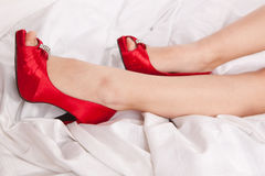 Woman's leg in red shoe Royalty Free Stock Image