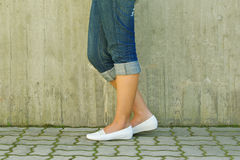 Woman's legs. In jeans rolled up Royalty Free Stock Image