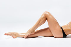 Woman's legs. Smooth female legs on white background stock photography