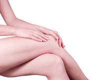 Woman's legs. Smooth female legs on a grey background Stock Images