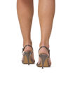 Woman's legs. Isolated woman's legs in highheels sandals.Natural look of the skin.Copyspace for your message in the lower part of the image Royalty Free Stock Images