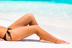 Woman's legs on the beach Stock Photography
