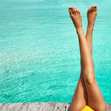 Woman at beach jetty Stock Photo