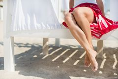 Woman's legs at beach. At sunny day Royalty Free Stock Images
