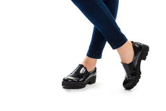 Woman's legs in black shoes. Dark navy pants and footwear. Brand new slip ons. Thick rubber sole Stock Images
