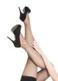 Woman's legs in black stockings and high heels. Royalty Free Stock Photos