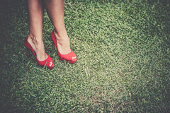 Woman's legs in bright red shoes with high heels Royalty Free Stock Photos