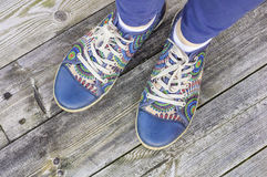 Woman`s legs with colorful sport shoes Royalty Free Stock Photography