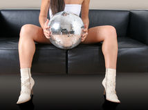 Woman's legs and discoball Royalty Free Stock Photos