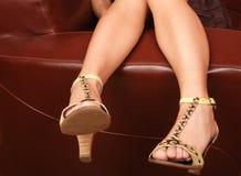Woman's legs in fancy high hills Stock Photo