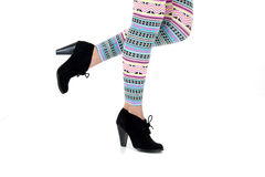 A womans legs in a fun colorful leggings pattern Royalty Free Stock Photos