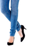 Woman's legs and high heeled shoes Stock Image