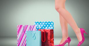 Woman`s legs in high heels with shopping bags in front of vignette Royalty Free Stock Photos