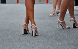 Woman's legs with high heels. Woman's legs with white high heels walking on the street Royalty Free Stock Photos