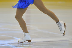 Woman's Legs in Ice Skates Royalty Free Stock Photo