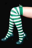 Woman S Legs In Green And White Stockings. Royalty Free Stock Photo
