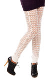 Woman's legs in a knitted leggings Royalty Free Stock Photo