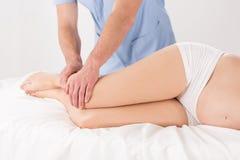 Woman's legs massage Stock Photos