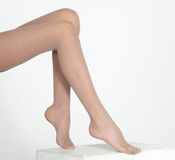 Woman's Legs in Nude Hose Against White Background Stock Photo