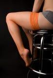 Woman's legs in orange Stock Photos