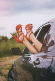 Woman's legs out of the car. Royalty Free Stock Photography