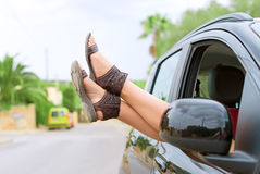 Woman's legs out of the car. Royalty Free Stock Photos