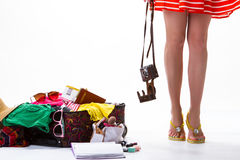 Woman's legs and overfilled suitcase. Royalty Free Stock Photos