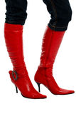 Woman's legs in red boots Stock Image