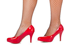 Woman's legs with red high hill shoes Royalty Free Stock Photography