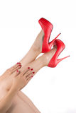 Woman's legs and red shoe Stock Photo